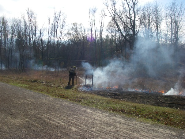 The crew very carefully burned around sensitive spots, like the Wet Prairie sign.