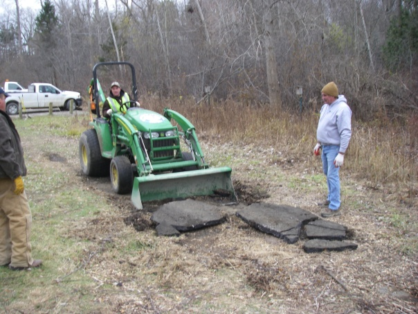 Lou (left), Jeff (on tractor), and Doug (right) tear out the asphalt patch by the Art Project. Thanks for your help!