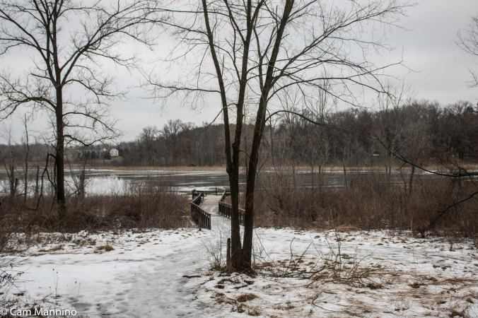 The lake after a thaw and rain but enough ice to support two ice fisherman (not pictured) sloshing along the surface.