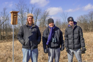 Left to right: The new bluebird house, volunteer Tom Korb, my husband Reg and Tom's nephew, Alex Korb.