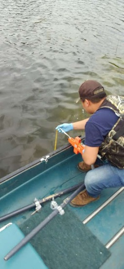 Grant checks the transparency of Twin Lake using a Secchi disc
